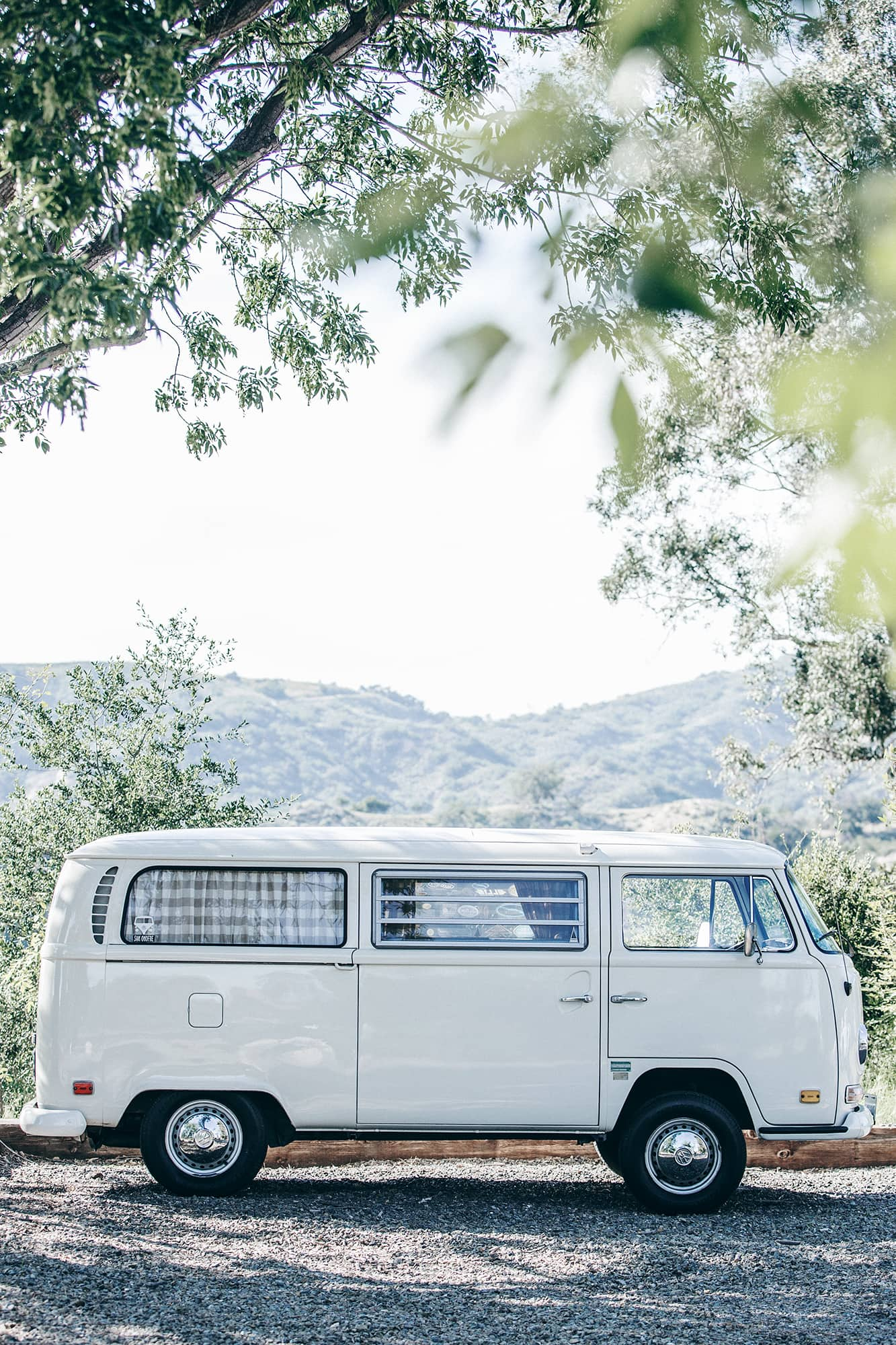 white vw bus camper in the mountains