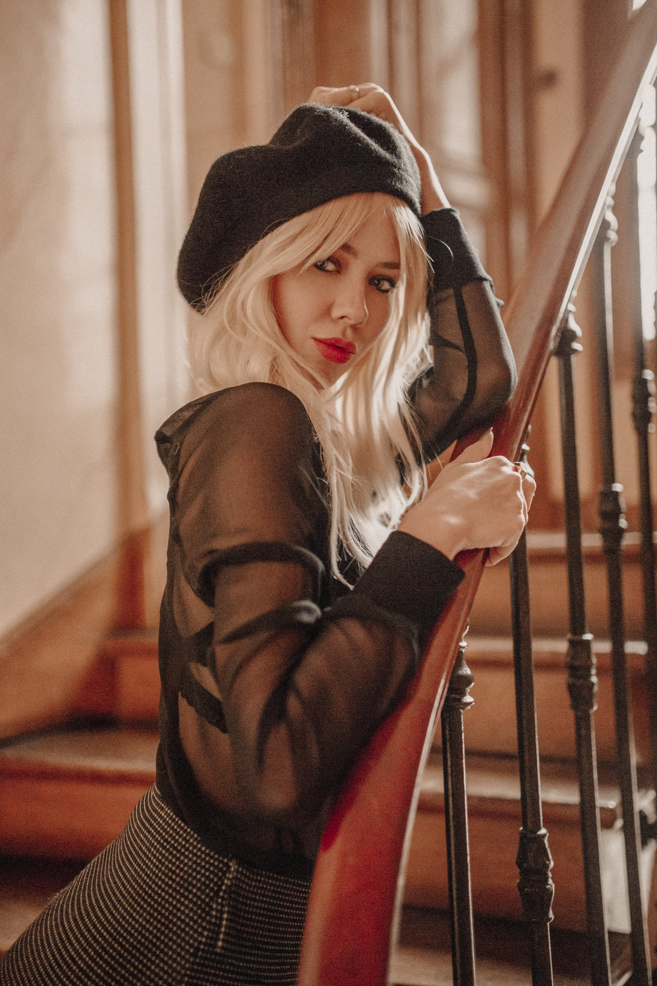 Sarah Loven wears vintage French style on Paris staircase
