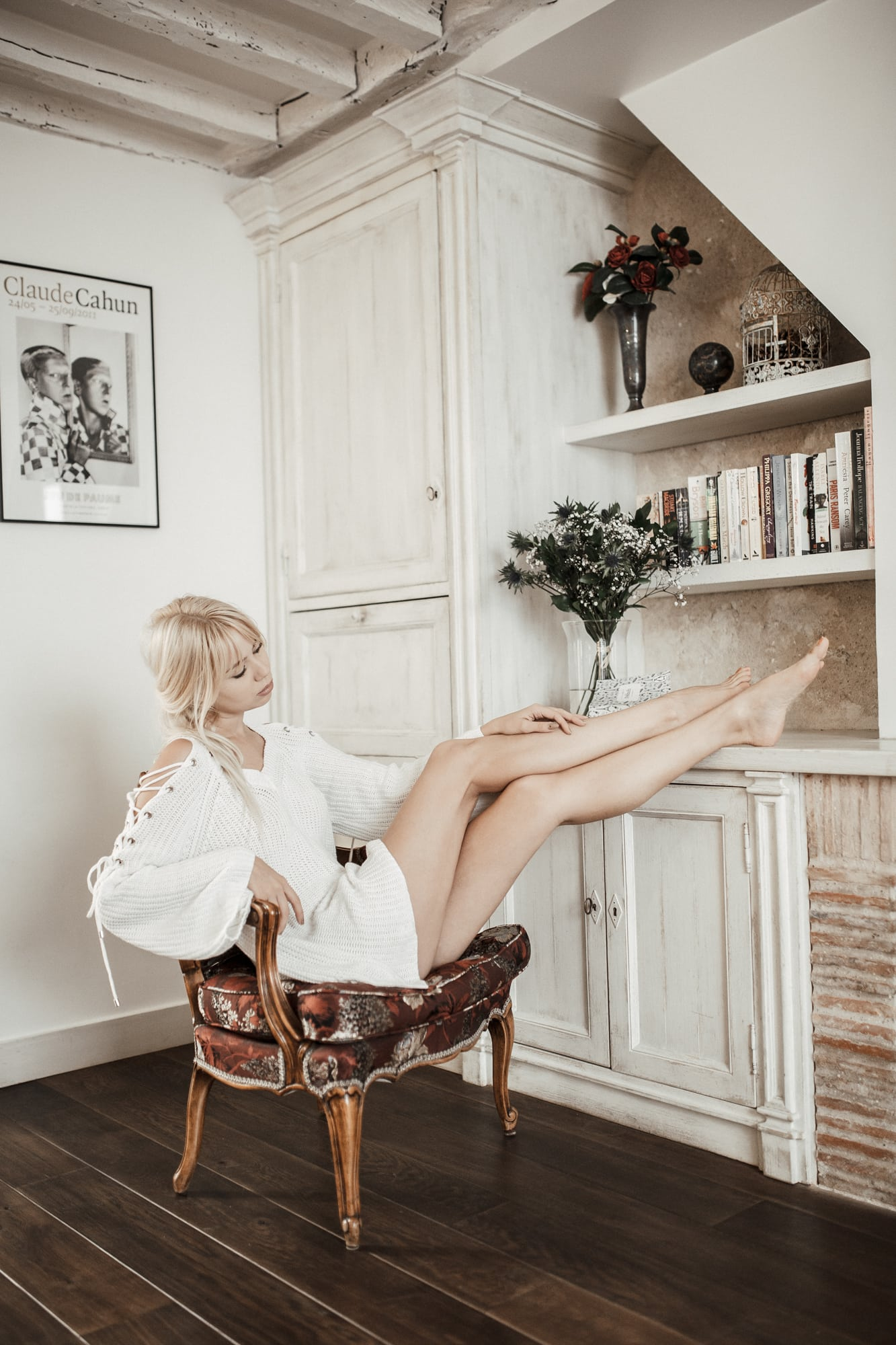 cozy white sweater and bare legs