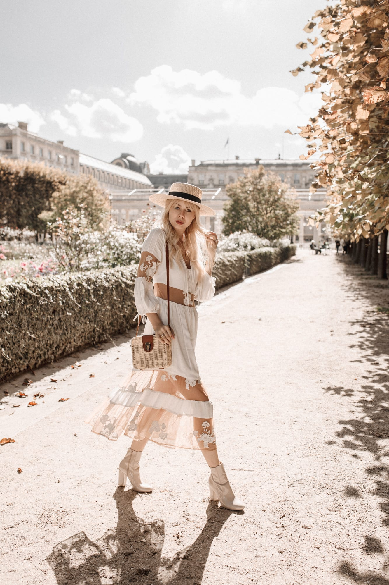 Sarah Loven wear white For Love & Lemons dress in Paris