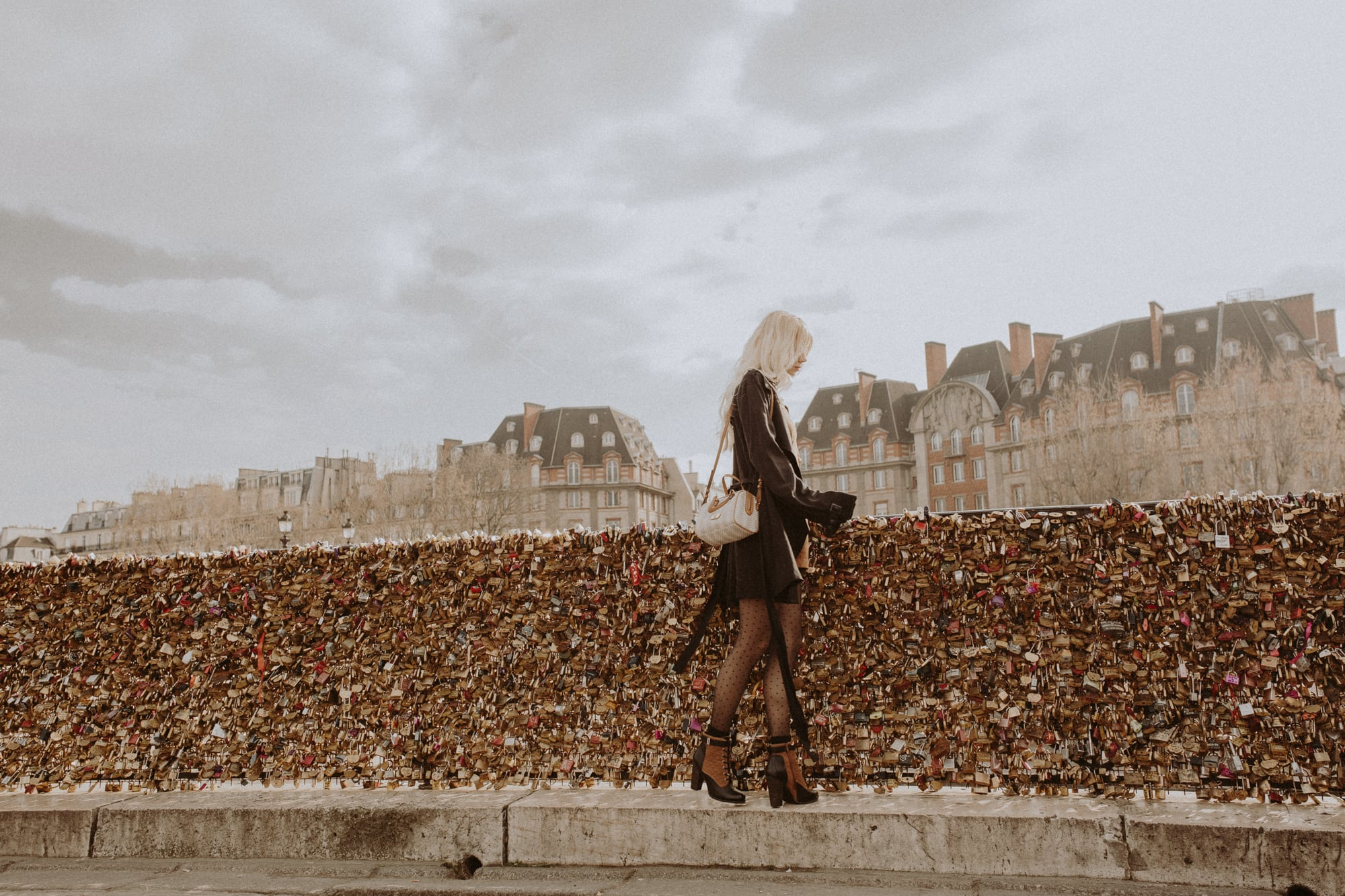 Sarah Loven walks at Post Nuef Bridge, Paris