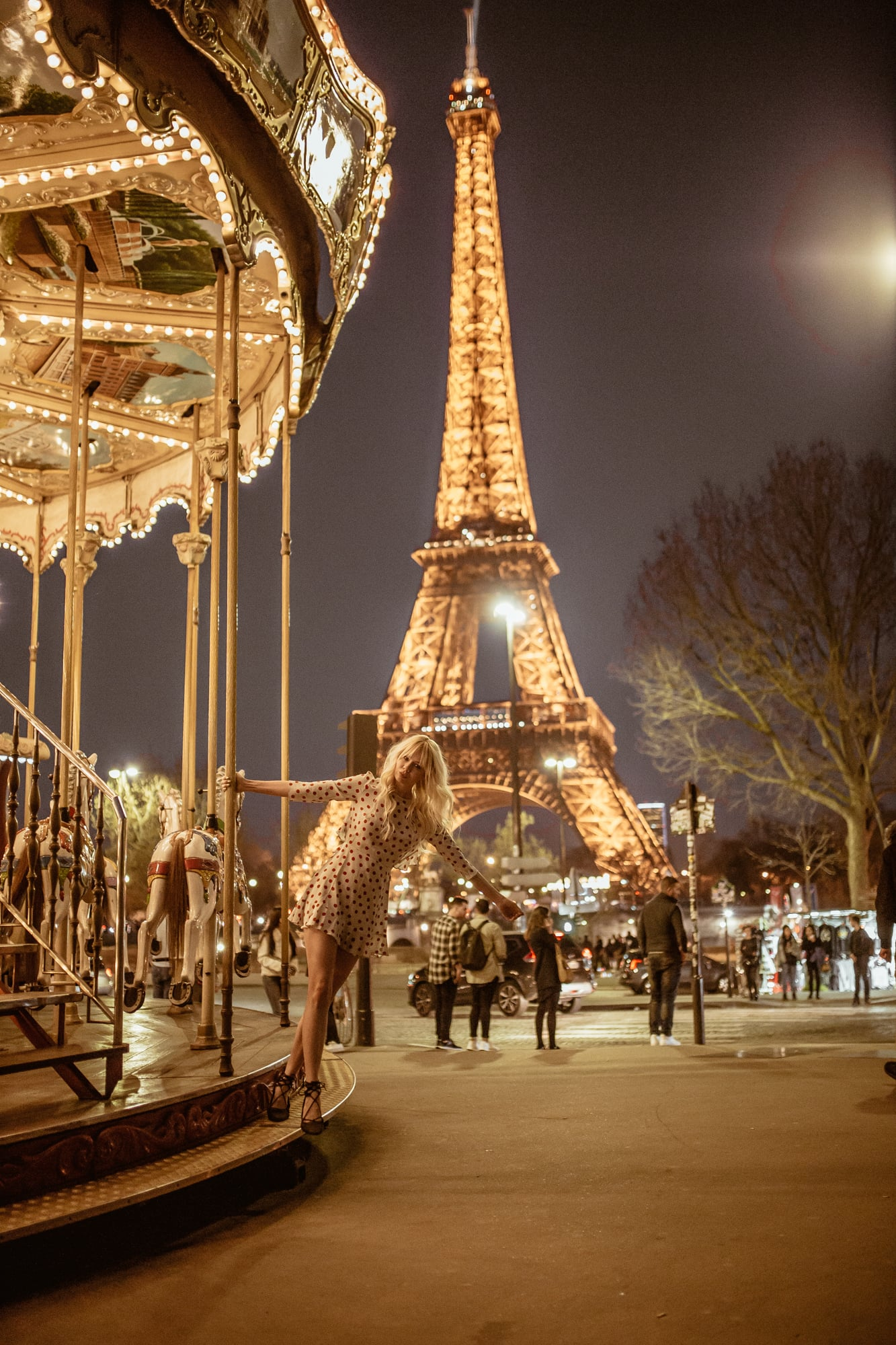 nighttime carousel ride in Paris