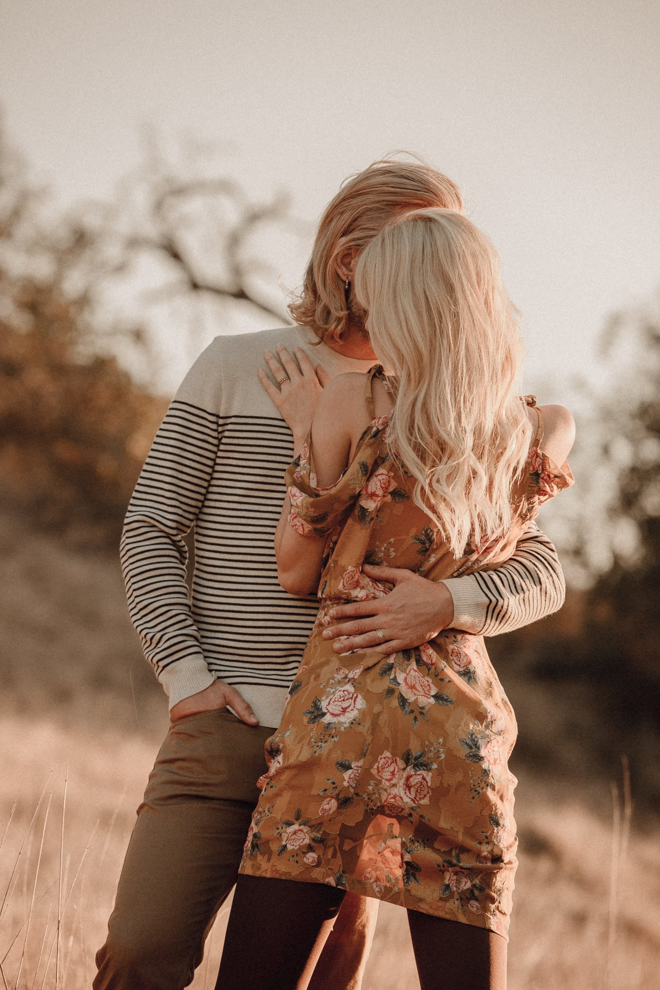 romantic engagement anniversary shoot in field