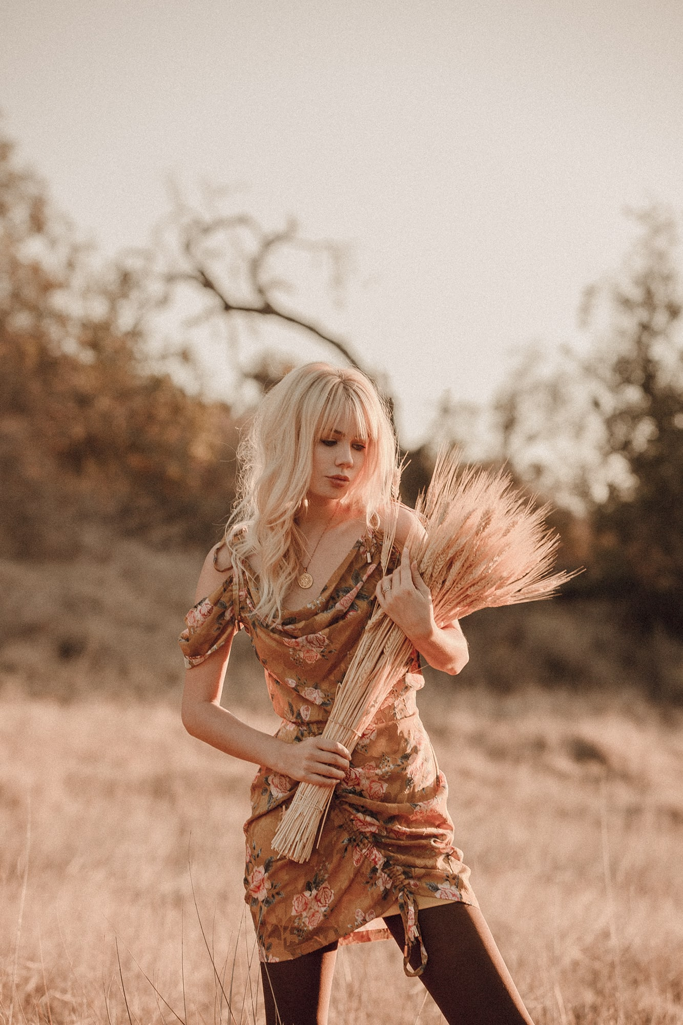 Sarah Loven in golden We Are Kindred floral mini dress