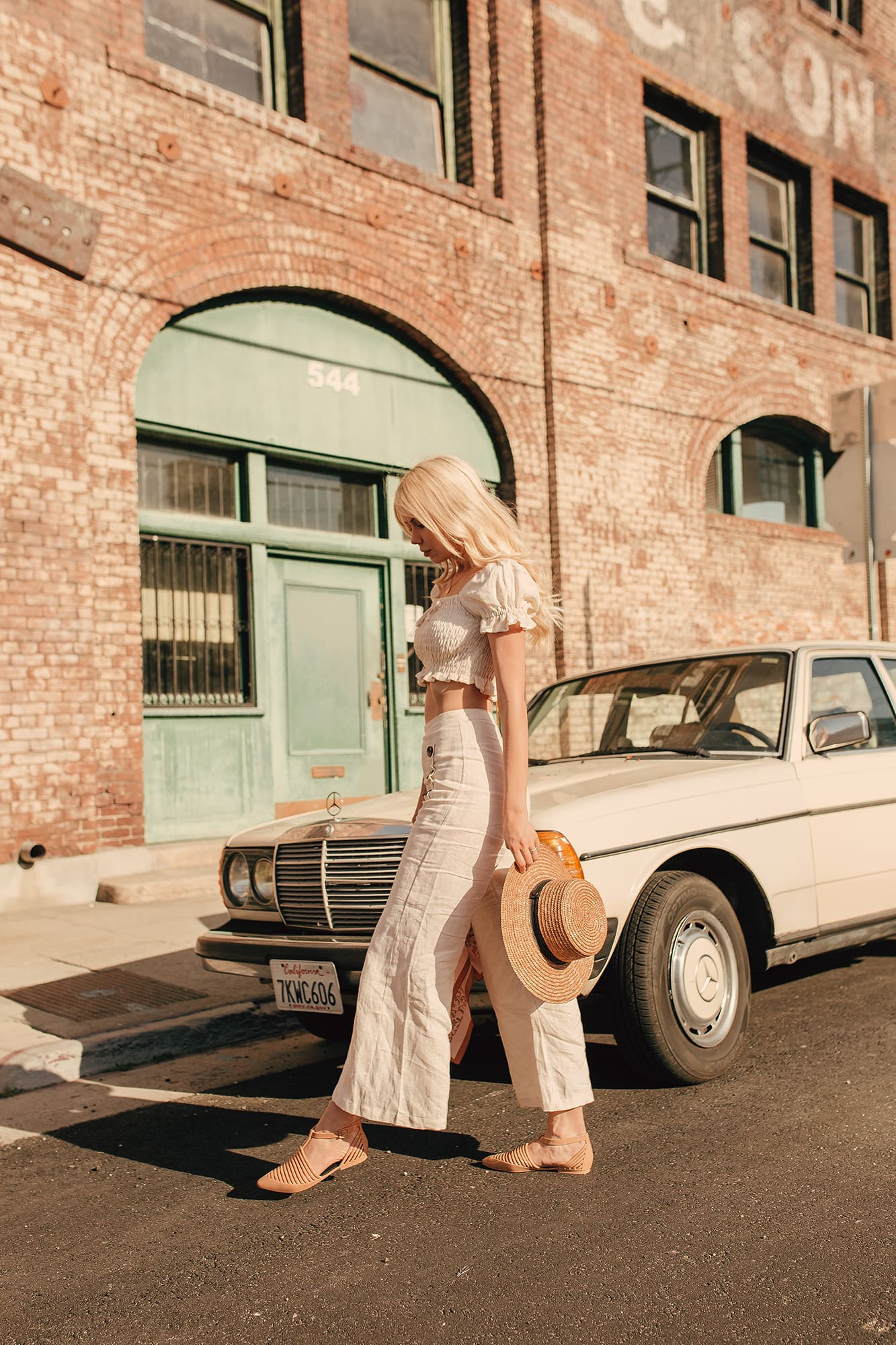 Blonde girl in vintage style by vintage car in DTLA