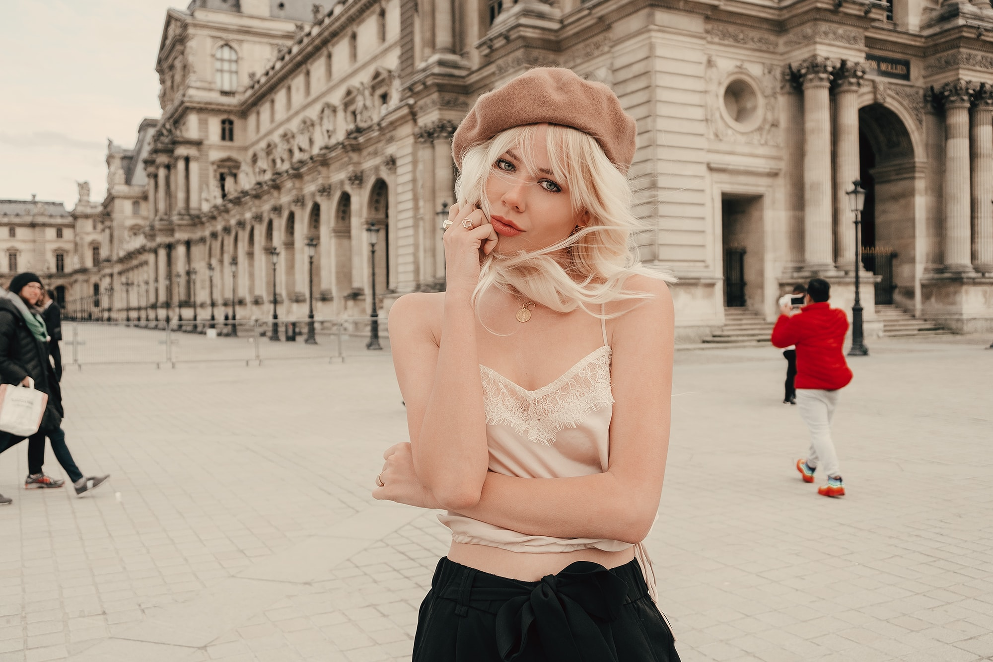 Sarah Loven in tan French beret at the Louvre in Paris