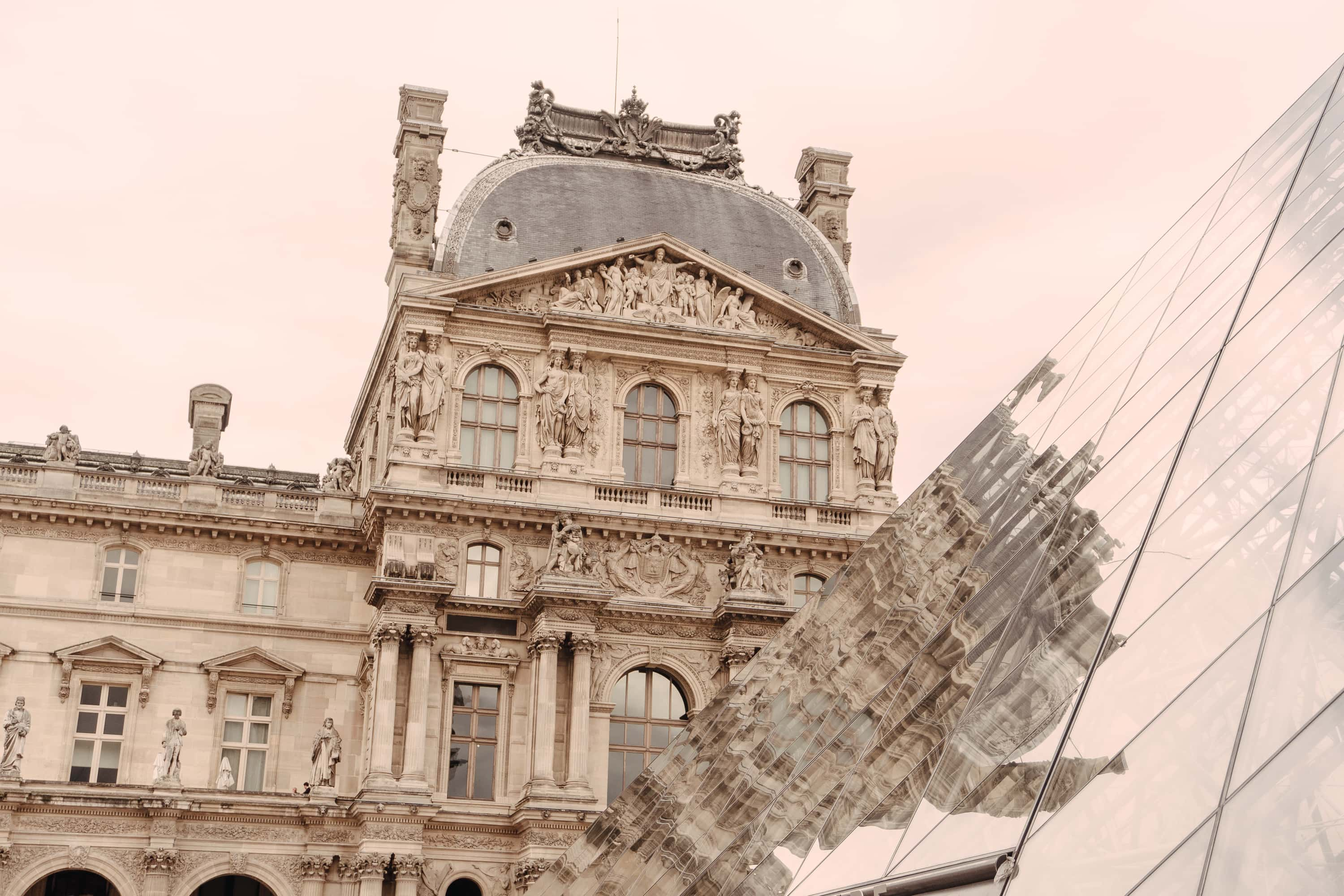 Reflection of the Louvre on glasswork pyramid
